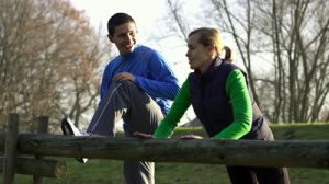 stock-footage-young-happy-couple-exercising-outdoors